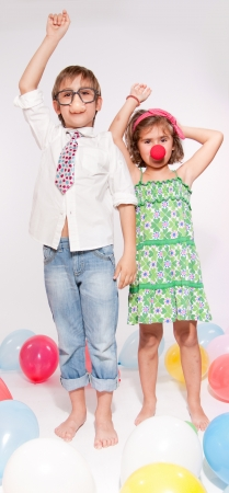 Little boy and girl with fake noses in a balloon party  photo
