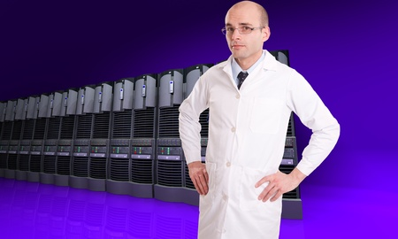 server farm:   Technician in a white robe on a background of server computers   Stock Photo