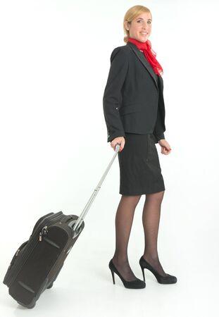 hotesse de l air: H�tesse de l'air sur la route, une valise Banque d'images
