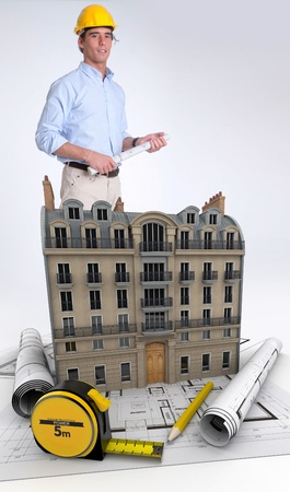 An Architect with blueprints on a building renovation Stock Photo - 18091743