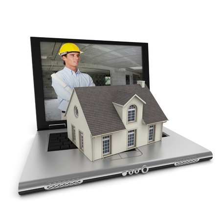 online safety: Open laptop with an architect on the screen, and a house model on the keyboard