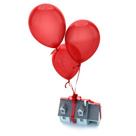 Floating balloons holding a house with a tied bow photo