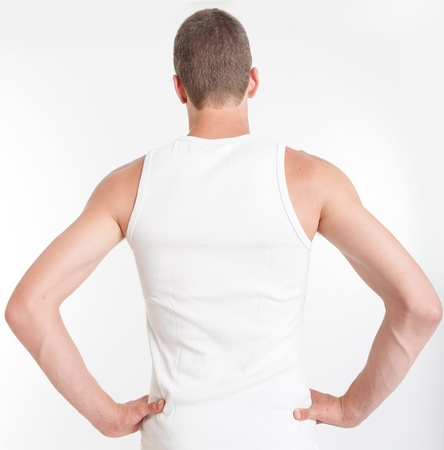Rear view of a male torso wearing a sleeveless shirt photo
