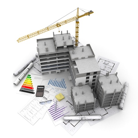 construction project: Building under construction with crane, on top of blueprints, mortgage applications and energy rating Stock Photo