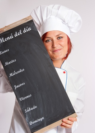 female chef:  Portrait of an smiling professional female chef holding a menu slate
