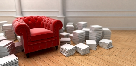 upholstered:  Red upholstered sofa surrounded by piles of books   Stock Photo