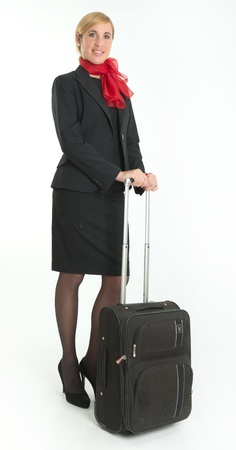 Air hostess on the go, carrying a suitcase photo