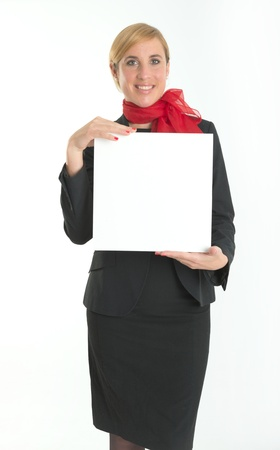board: Smiling hostess holding a blank board ideal for inserting your own message Stock Photo