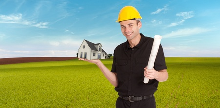 prefabricated building: An architect in a field holding a house in his hands