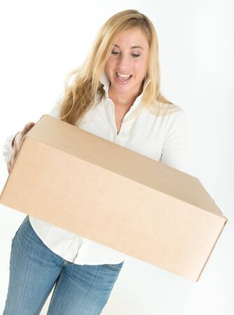 Happy woman holding a parcel photo
