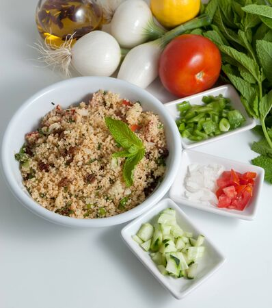 Refreshing tabouleh salad surrounded by healthy ingredients photo