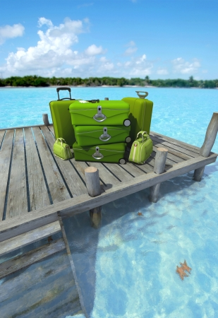 A pile of luxurious luggage standing by the pier on a tropical landscape Stock Photo - 18385900