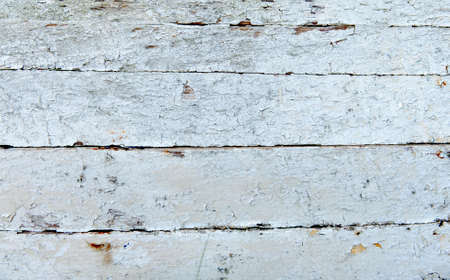 peeled off: An old wooden surface painted in white