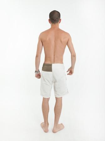 hombres sin camisa: Vista trasera de un hombre joven con traje de ba�o