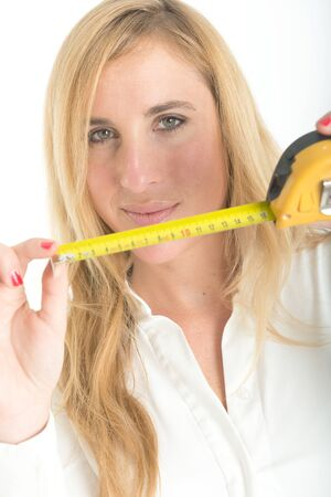 suggesting: Woman holding a tape measure, suggesting home improvement