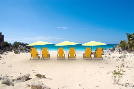 sunshades: Tropical cove with white and yellow sunshades and reclining chairs