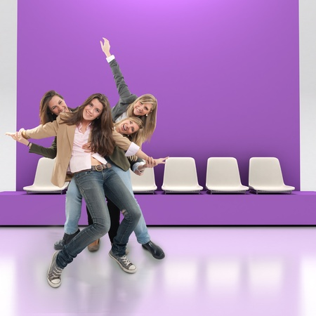 A group of happy women having fun indoors with lots of copy space photo