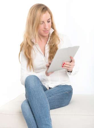 Portrait of an attractive young blonde using a tablet pc Stock Photo - 18465152