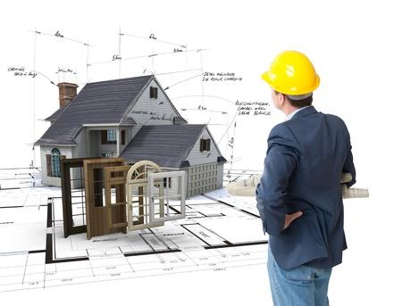 arquitecto: Arquitecto que mira una casa en modelos con una selecci�n de ventanas y puertas