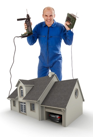 refurbish: Crazy Handyman holding his tools by a model house