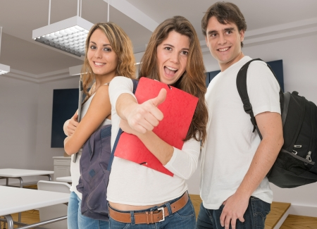 faculty: Happy young people in a classroom Stock Photo