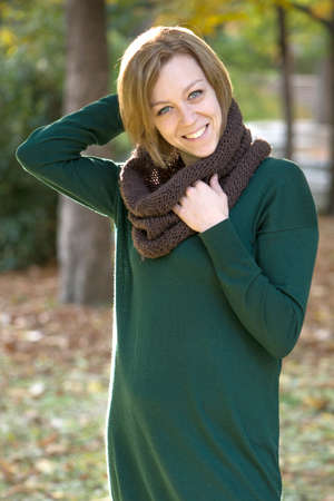 ginger haired: Ginger haired young woman in the park on an autumn day Stock Photo