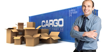 Happy businessman with a cargo container and boxes on the background photo