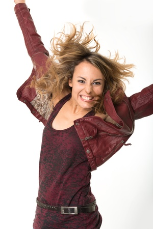 euphoric: Jumping girl in leather jacket with a happy expression
