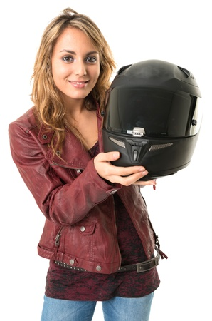 Young female biker holding a crash helmet photo