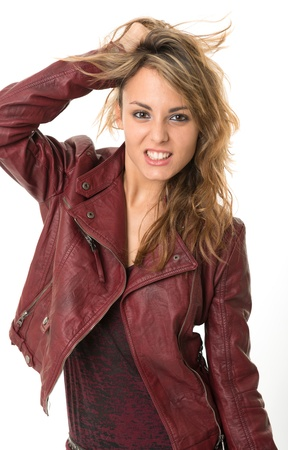 irritating: Rebellious looking young woman in leather jacket Stock Photo