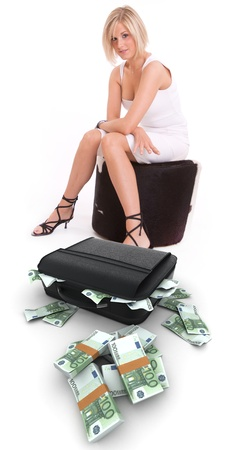 bribe: Young woman with a suitcase full of hundred euro bills