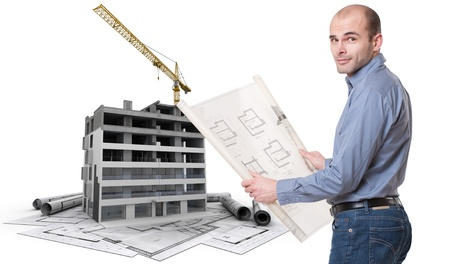 property development: An architect, a building in construction, and blueprints