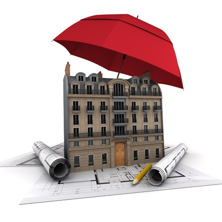 An umbrella protecting a building and blueprints photo
