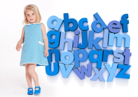 language school: Little girl by an alphabet in blue shades Stock Photo