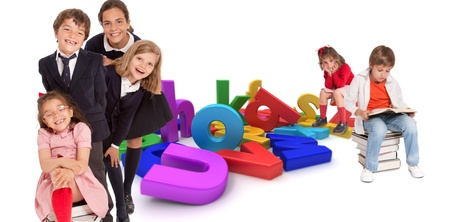 small group: Happy kids with different ages around a multicolored alphabet Stock Photo