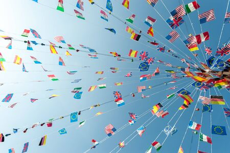 feast: Party flags blowing against the sky in a clear summer afternoon Stock Photo