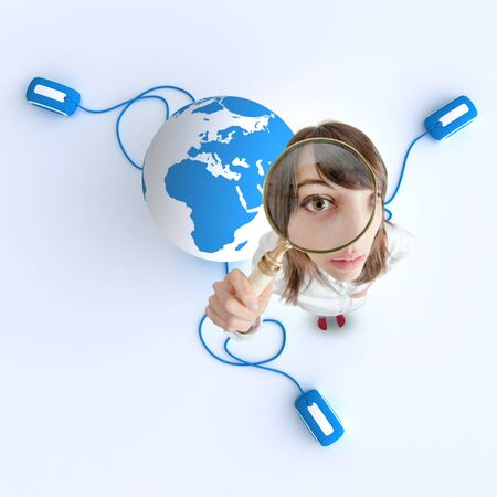 Woman with magnifying glass and the Earth with computer mouse Stock Photo - 19192186