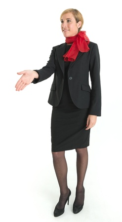 uniform attire: Smiling hostess offering her hand for a handshake Stock Photo