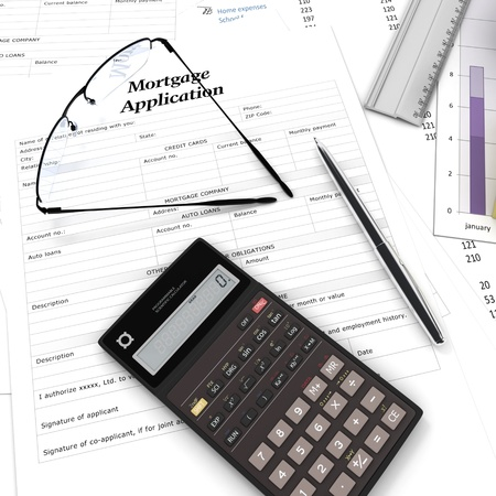 suggesting: A mortgage application form, some graphics a calculator and reading glasses, suggesting home buying decision
