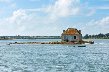 islet: Picturesque house in a little islet Stock Photo