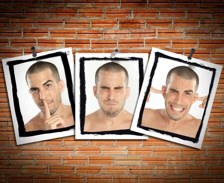 posted: Succession of pictures posted on a brick wall of a young man mimicking see no evil, hear no evil, speak no evil Stock Photo