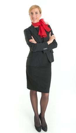 hotesse de l air: Sourire hôtesse avec l'uniforme noir et écharpe rouge