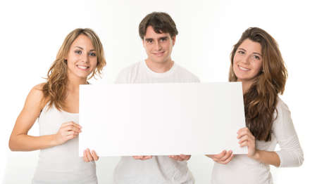 Three young people holding a blank sign, ideal for inserting your own message photo