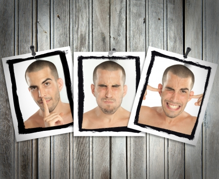 posted: Succession of pictures posted on a wooden wall of a young man mimicking see no evil, hear no evil, speak no evil Stock Photo