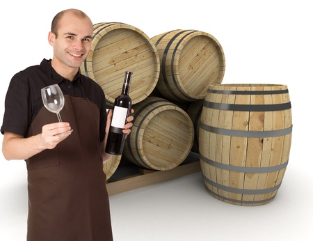 Young man holding a wine bottle and a wineglass, with wine barrels at the background photo