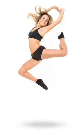 modern dance: Young woman in modern dance clothes jumping