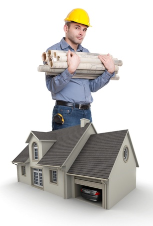 Man with helmet, carrying blueprints by a house model photo