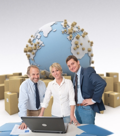 Work team around a computer in an international transportation context photo
