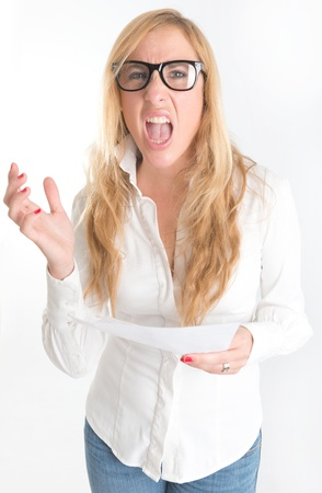 Woman with shocked expression examining a document through her reading glasses photo