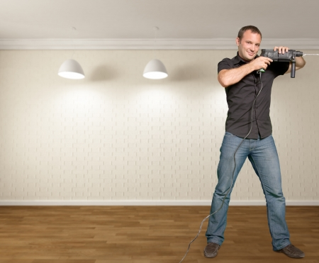 hand drill: Man with a hand drill in a new home interior Stock Photo